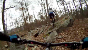 Following Brice through the rocky terrain on our pre-ride.